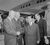 Ngo Dinh Diem, accompanied by U.S. Secretary of State John Foster Dulles, arrives at Washington National Airport in 1957. Diem is shown shaking the hand of U.S. President Dwight D. Eisenhower.
